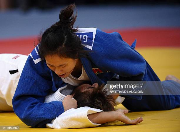 China's Zhu Guirong fights against Uzbekistan's Shoira Masharipova during their qualifier match in the 57kg category at the Judo World Championships...