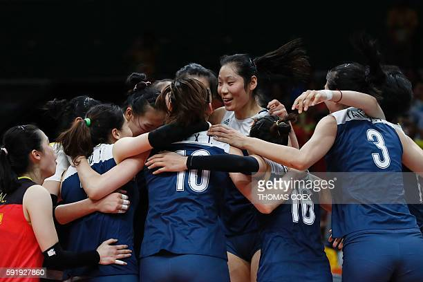 China's Zhu Ting and teammates react after winning their women's semifinal volleyball match against the Netherlands at Maracanazinho Stadium in Rio...