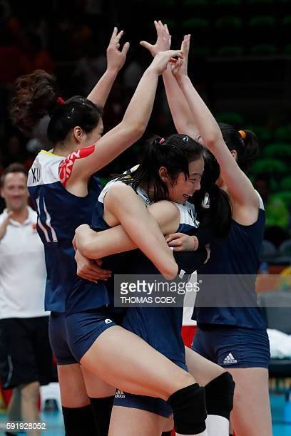 China's Zhu Ting hugs a teammate as they celebrate after winning their women's semifinal volleyball match against the Netherlands at Maracanazinho...