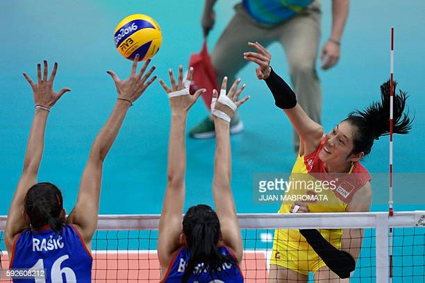 China's Zhu Ting spikes the ball during the women's Gold Medal volleyball match between China and Serbia at Maracanazinho Stadium in Rio de Janeiro...