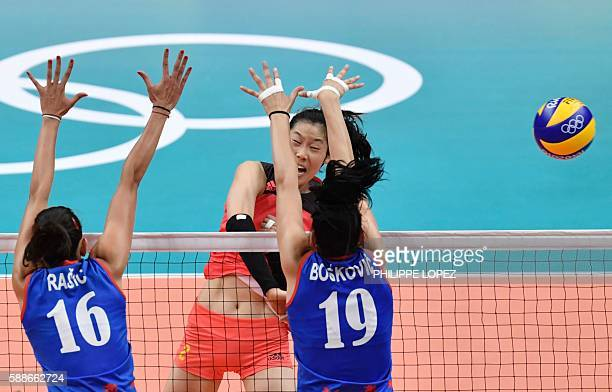 China's Zhu Ting spikes the ball during the women's qualifying volleyball match between China and Serbia at Maracanazinho Stadium in Rio de Janeiro...