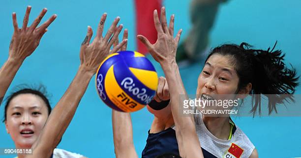 China's Zhu Ting spikes the ball during the women's quarterfinal volleyball match between Brazil and China at the Maracanazinho stadium in Rio de...