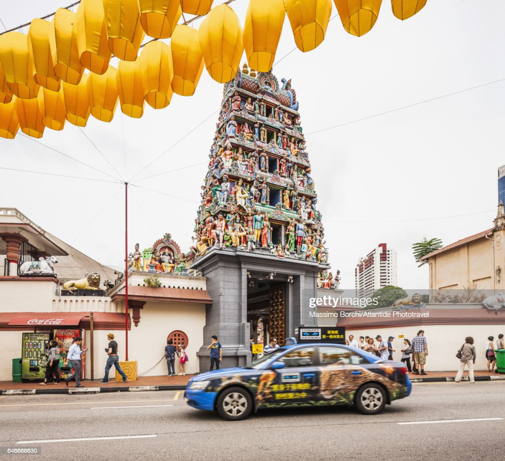 Chinatown, taxi near the entrance of Sri Mariamman Temple, in the upper part decorations for New Chinese Year : Stock Photo
