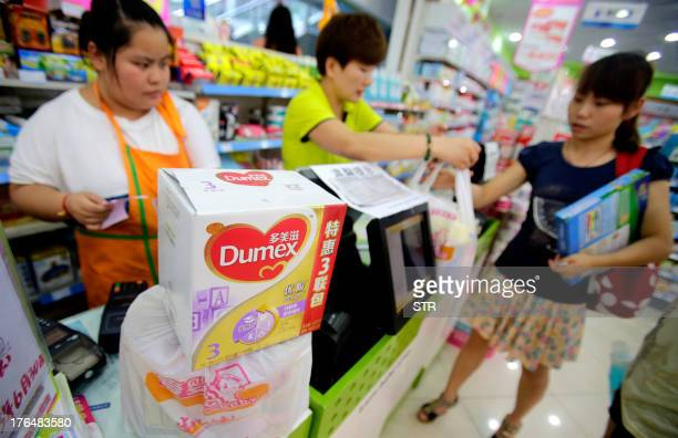 ChinatradepharmafoodmilkANALYSIS by Julien Girault This picture taken on August 7 2013 shows a box of Dumex baby formula being returned to a...