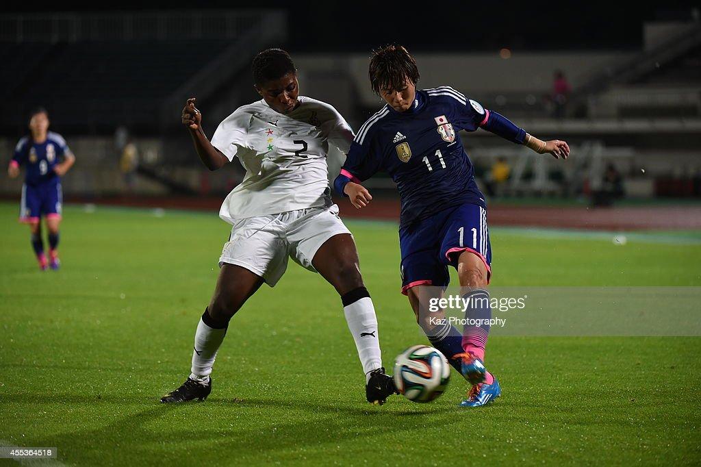 Chinatsu Kira of Japan shoots the ball under the challenge from Hillia Mantenn Kobblah of Ghana during the women's international friendly match...