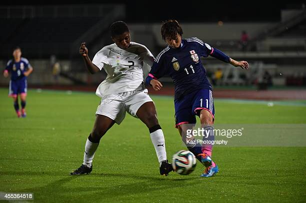 Chinatsu Kira of Japan shoots the ball under the challenge from Hillia Mantenn Kobblah of Ghana during the women's international friendly match...