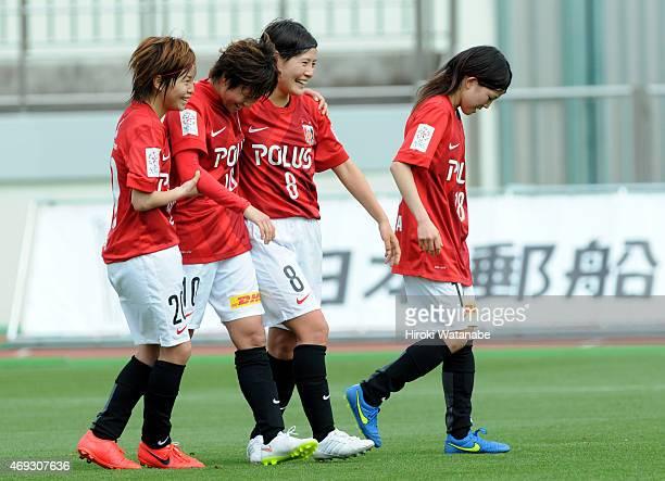 Chinatsu Kira of Urawa Reds Ladies celebrates scoring her team's third goal with her team mates during the Nadeshiko League match between Urawa Red...