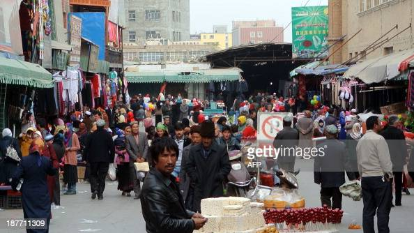 ChinaXinjiangunrestTiananmenFOCUS by Carol Huang This picture taken on November 6 2013 shows a crowd of mainly Uighur shopping at a bazaar in Hotan...
