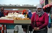 ChinaXinjiangunrestTiananmenFOCUS by Carol Huang This picture taken on November 6 2013 shows Uighur women shopping at a bazaar in Hotan farwest...