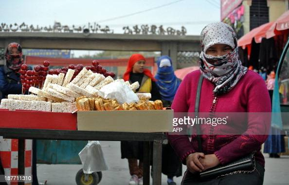 ChinaXinjiangunrestTiananmenFOCUS by Carol Huang This picture taken on November 6 2013 shows Uighur women shopping at a bazaar in Hotan farwest...