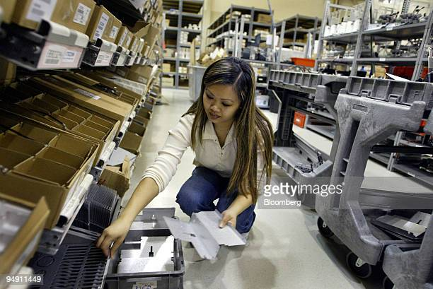 Chinda Sengsouvanh collects the components for an order to be assembled at the Danfoss Drives manufacturing plant in Rockford Illinois January 6 2004...