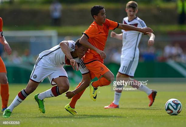 Chinedu Ekene of Germany is challenged by Justin Kluivert of the Netherlands during the international friendly U15 match between Germany and...