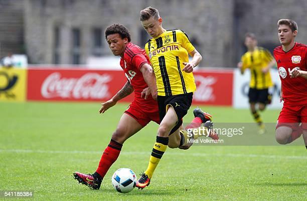 Chinedu Ekene of Leverkusen challenges Dominik Wanner of Dortmund during the U17 German Championship Final match between Borussia Dortmund U17 and...