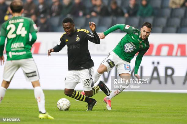 Chinedu Obasi of AIK and Dzenis Kozica of Jonkopings Sodra competes for the ball during the Allsvenskan match between AIK and Jonkopings Sodra IF at...