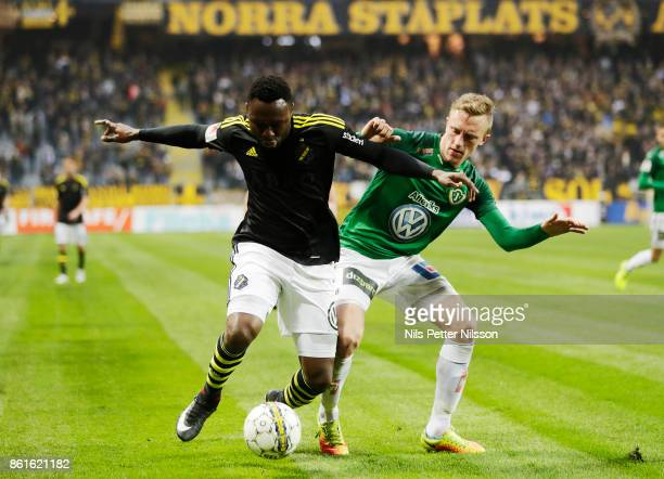 Chinedu Obasi of AIK and Joakim Karlsson of Jonkopings Sodra competes for the ball during the Allsvenskan match between AIK and Jonkopings Sodra IF...