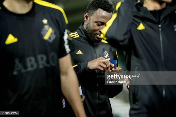 Chinedu Obasi of AIK looks at his silver medal after the Allsvenskan match between Orebro SK AIK at Behrn Arena on November 5 2017 in Orebro Sweden
