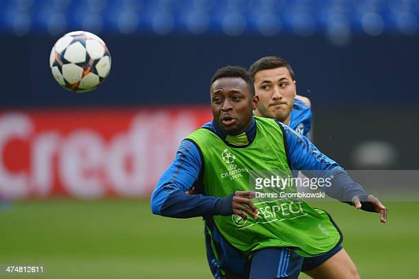 Chinedu Obasi of FC Schalke 04 is chased by Sead Kolasinac during a training session ahead of the Champions League match between FC Schalke 04 and...