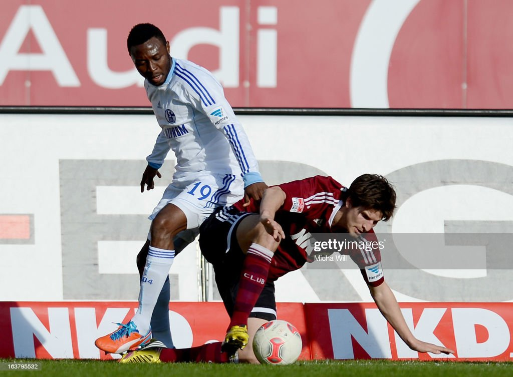 Chinedu Obasi (L) of Schalke challenges Timm Klose of Nuernberg during the Bundesliga match between 1. FC Nuernberg and FC Schalke 04 at Grundig-Stadion on March 16, 2013 in Nuremberg, Germany.