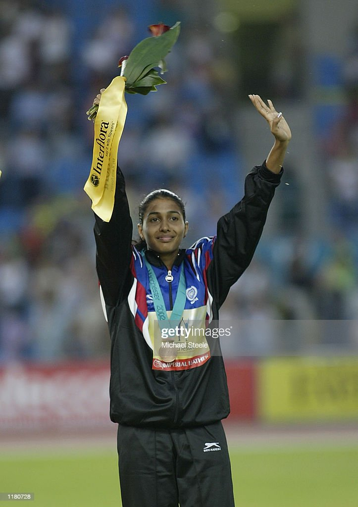 Chinedu Odozor of India celebrates bronze during the medal ceremony of the Women's Long Jump at the City of Manchester Stadium during the 2002 Commonwealth Games in Manchester in England on July 29, 2002.