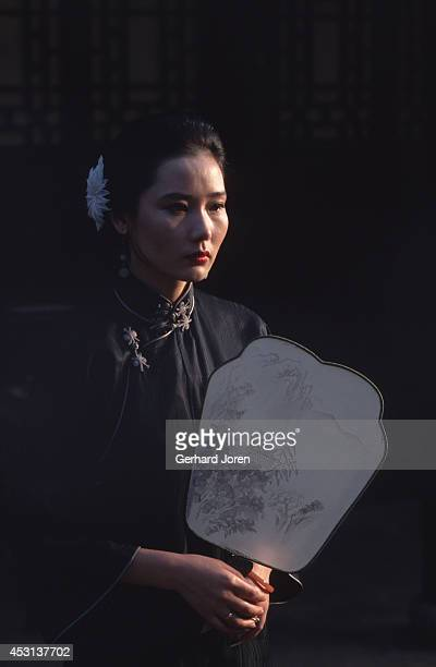 Chines actress He Sai Fei during the filming of Chen Kaige's 'Temptress Moon' in an old tea house in Suzhou
