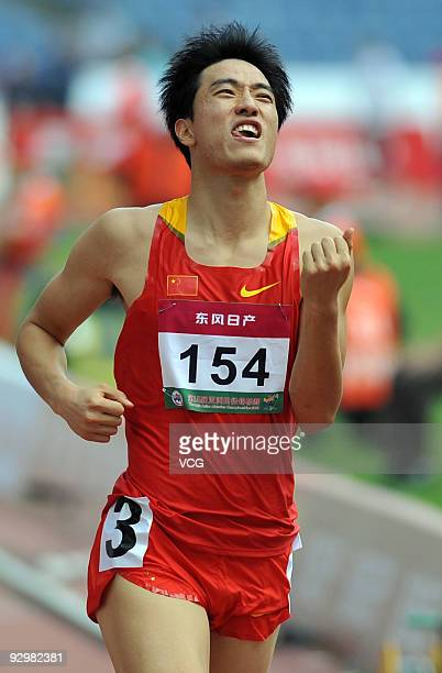 Chinese 110 meters hurdler Liu Xiang celebrates after the men's 110m hurdles of athletics at the first round of 18th Asian Athletics Championships on...
