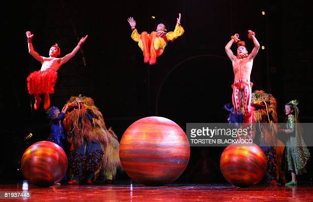 Chinese acrobats do sommersaults on giant balls during the final dress rehearsal of Cirque du Soleil's 'Dralion' in Sydney on July 15 2008 The show...