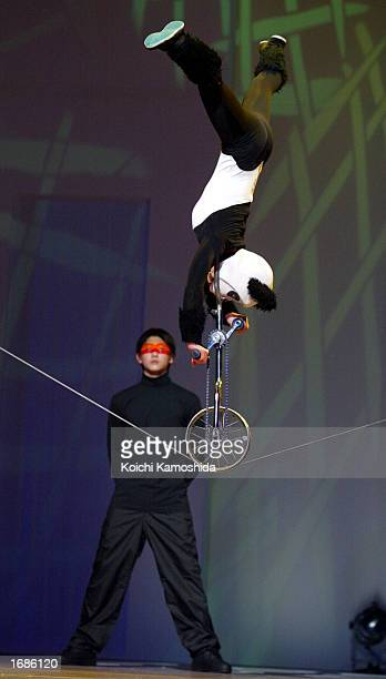 Chinese acrobats members of the elite 'Golden Lions' perform December 13 2002 in Tokyo Japan The performance involving Chinese acrobats with a team...