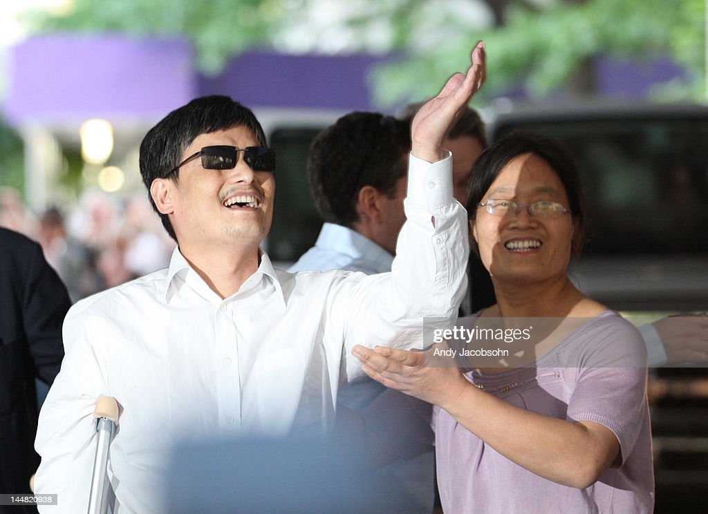 Chinese activist Chen Guangcheng gesters before making remarks to the media upon arriving on the campus of New York University on May 19 2012 in New...