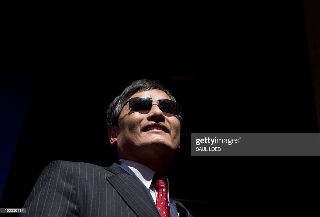 Chinese activist lawyer Chen Guangcheng leaves after being presented with the Tom Lantos Human Rights Prize during a ceremony at the US Capitol in Washington, DC, on January 29, 2013. The prize, awarded annually, honors Guangcheng for his work advocating on behalf of tens of thousands of Chinese fighting for human rights. AFP PHOTO / Saul LOEB