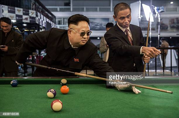 Chinese actor and North Korean leader Kim Jung Un impersonator Jia Yongtang center and United States President Barack Obama impersonator Xiao...