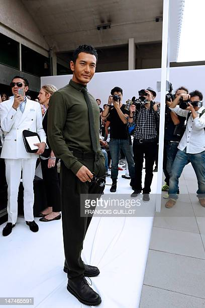 Chinese actor and singer Huang Xiaoming is pictured before the start of the men's springsummer 2013 fashion collection show of Belgian designer Kris...