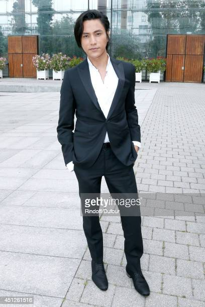 Chinese actor Chen Kun attends the Louis Vuitton show as part of the Paris Fashion Week Menswear Spring/Summer 2015 on June 26 2014 in Paris France