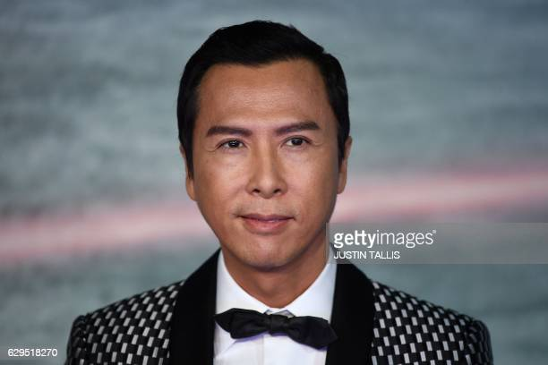 Chinese actor Donnie Yen poses upon arrival at the UK launch event of Lucasfilm's 'Rogue One A Star Wars Story' at the Tate Modern in central London...