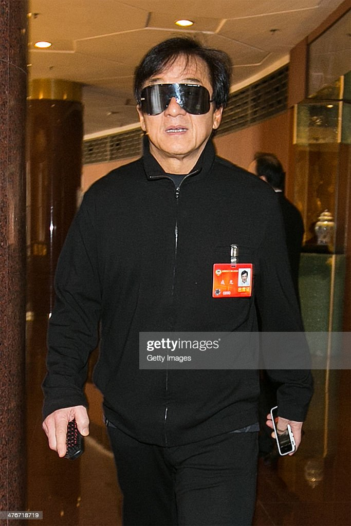 Chinese actor <a gi-track='captionPersonalityLinkClicked' href=/galleries/search?phrase=Jackie+Chan&family=editorial&specificpeople=171455 ng-click='$event.stopPropagation()'>Jackie Chan</a> attends the the second session of the 12th National Committee of CPPCC at the The Great Hall of the People on March 4, 2014 in Beijing, China.