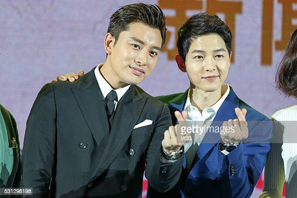 Chinese actor Jia Nailiang and South Korean actor Song Joongki meet fans on May 13 2016 in Beijing China