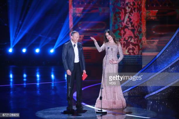 Chinese actor Jin Shijie and Italian actress Maria Grazia Cucinotta attend the closing ceremony of 2017 Beijing International Film Festival on April...