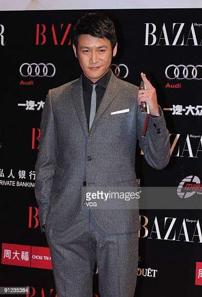 Chinese actor Lu Yi poses on the red carpet prior to the Bazaar charity event n September 28 2009 in Beijing China