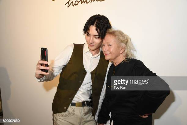 Chinese actor Ruichang Wang and Agnes B pose for a selfie during Agnes B Menswear Spring/Summer 2018 show as part of Paris Fashion Week ton June 25...