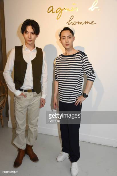 Chinese actor Ruichang Wang and chinese actor Wenzuo Song pose during Agnes B Menswear Spring/Summer 2018 show as part of Paris Fashion Week ton June...