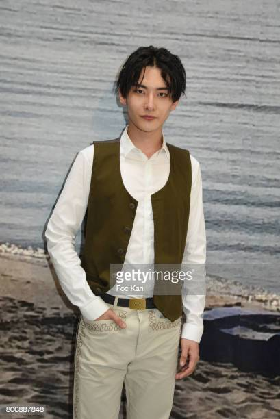 Chinese actor Ruichang Wang poses during Agnes B Menswear Spring/Summer 2018 show as part of Paris Fashion Week ton June 25 2017 in Paris France