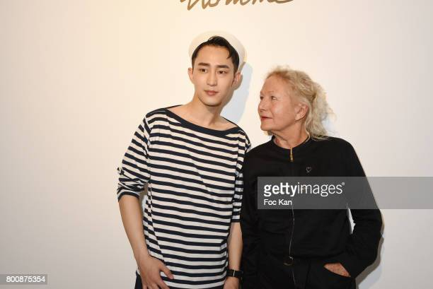 Chinese actor Wenzuo Song and Agnes B pose during Agnes B Menswear Spring/Summer 2018 show as part of Paris Fashion Week ton June 25 2017 in Paris...