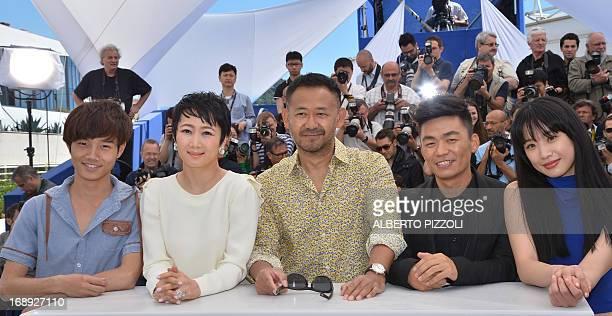 Chinese actors Luo Lanshan Zhao Tao Wu Jiang Wang Baoqiang and Meng Li pose on May 17 2013 during a photocall for the film 'Tian Zhu Ding' presented...