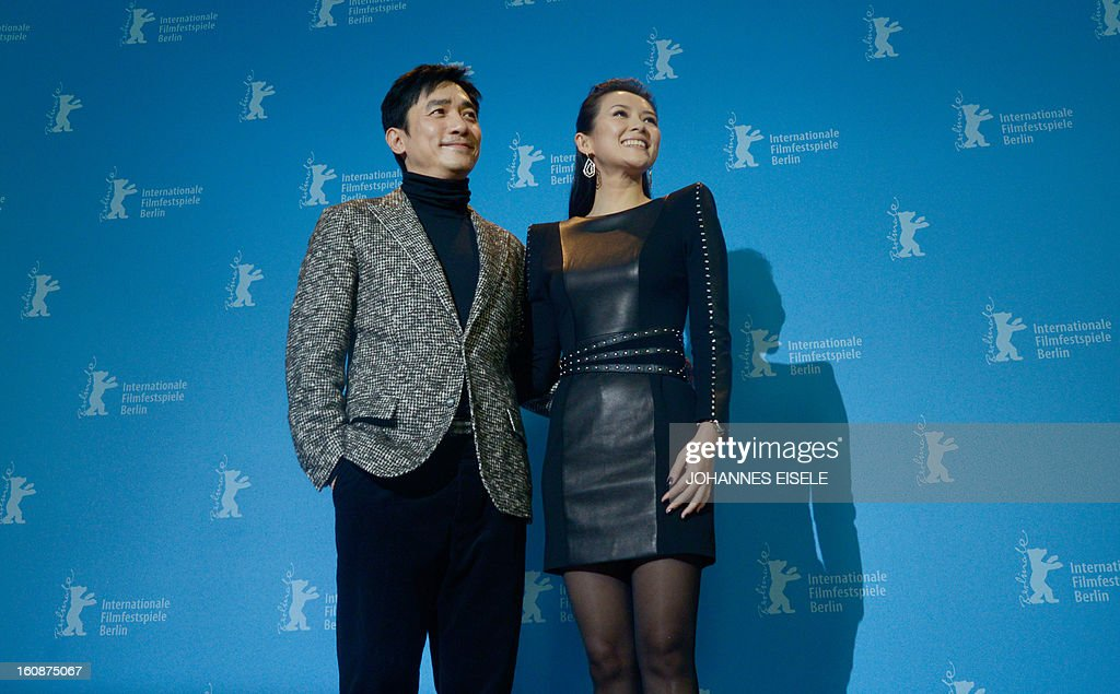 Chinese actors Tony Leung (L) and Zhang Ziyi pose for photographers during a photocall for their film 'Yi dai zong shi' (The Grandmaster) in Berlin, February 7, 2013. The 63rd Berlin film festival opens with a gala screening of Chinese director Wong Kar Wai's martial arts epic about the mentor of kung fu superstar Bruce Lee.