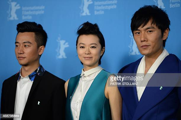 Chinese actors Xuan Huang Lu Huang and Qin Hao pose at a photocall for the film 'Tui Na' presented in the Berlinale Competition of the 64rd Berlinale...