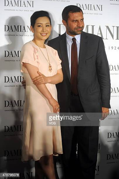 Chinese actress Amanda Qin pose with Giorgio Damiani the third generation of Damiani jewelry during the press conference of 'Damiani Metropolitan...