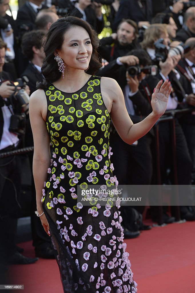 Chinese actress and member of the Un Certain Regard Jury Zhang Ziyi waves on May 26, 2013 as she arrives for the screening of the film 'Zulu' presented Out of Competition at the 66th edition of the Cannes Film Festival in Cannes. AFP PHOTO / ANNE-CHRISTINE POUJOULAT