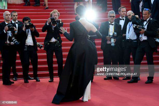 Chinese actress and singer Li Yuchun poses as she arrives for the screening of the film 'The Little Prince' at the 68th Cannes Film Festival in...