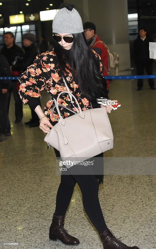 Chinese actress Fan Bingbing arrives in Shanghai from the Paris Fashion Week, at Shanghai Pudong International Airport on March 9, 2014 in Shanghai, China.