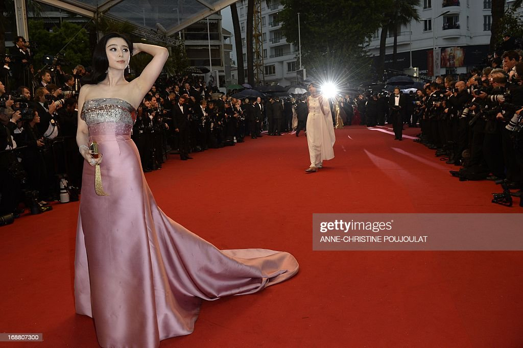 Chinese actress Fan Bingbing poses on May 15, 2013 as she arrives for the screening of the film 'The Great Gatsby' ahead of the opening of the 66th edition of the Cannes Film Festival in Cannes. Cannes, one of the world's top film festivals, opens on May 15 and will climax on May 26 with awards selected by a jury headed this year by Hollywood legend Steven Spielberg. AFP PHOTO / ANNE-CHRISTINE POUJOULAT