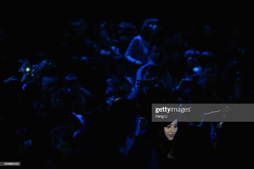 Chinese actress Fan Bingbing watches the show during VISCAP Yuan Bing Collection on the third day of Mercedes-Benz China Fashion Week Autumn/Winter 2013/2014 at Banquet Hall of Beijing Hotel on March 26, 2013 in Beijing, China.
